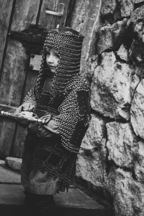 child wearing chain mail