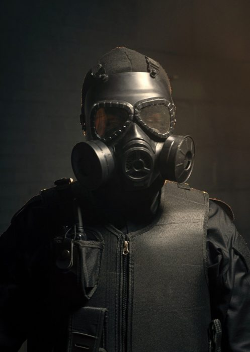 gas mask worn by policeman