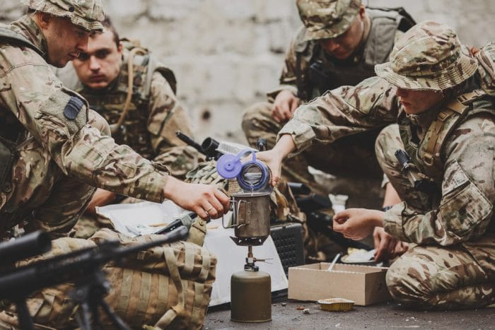Soldiers,Team,Eating,On,The,Battlefield